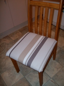 One of the newly re-upholstered chairs.  They got better as I went along...