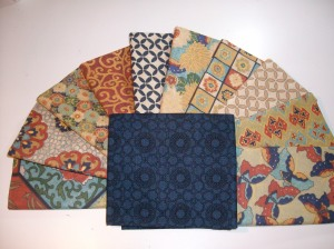 The fabric range for the Car Quilt. You get a better idea from this.  These fat quarters will make the borders round the central hexagon panel.